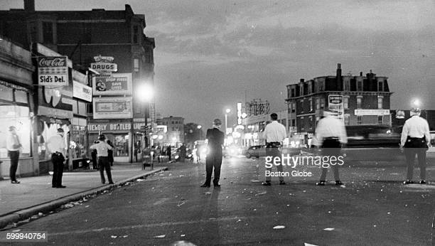 Police stand in the street during a riot in the Roxbury neighborhood of Boston on June 1, 1967.