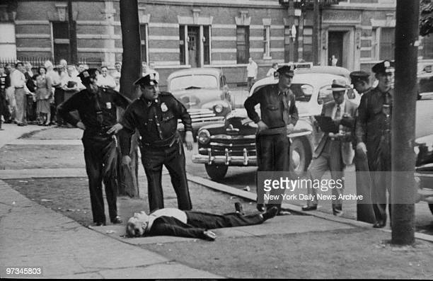 Police stand near body of detective Michael Dwyer a veteran of the Wall Street squad who drew his 38caliber on police near the 15th St entrance of...