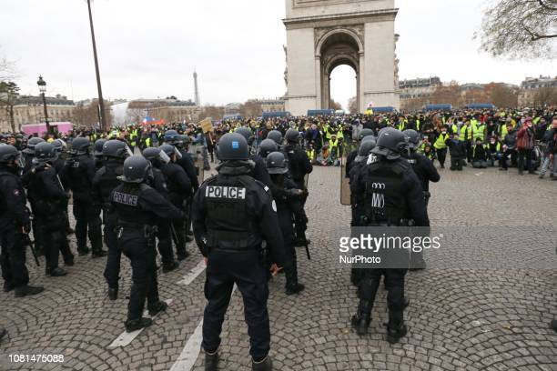 Police stand near the Arc de Triomphe during an antigovernment demonstration called by the quotYellow Vestquot movement on the Place de L'Etoile in...