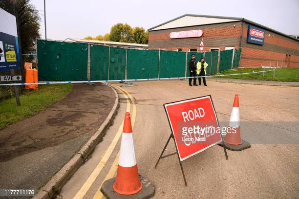 Police stand near the site where 39 bodies were discovered in the back of a lorry on October 23, 2019 in Thurrock, England. The lorry was discovered...