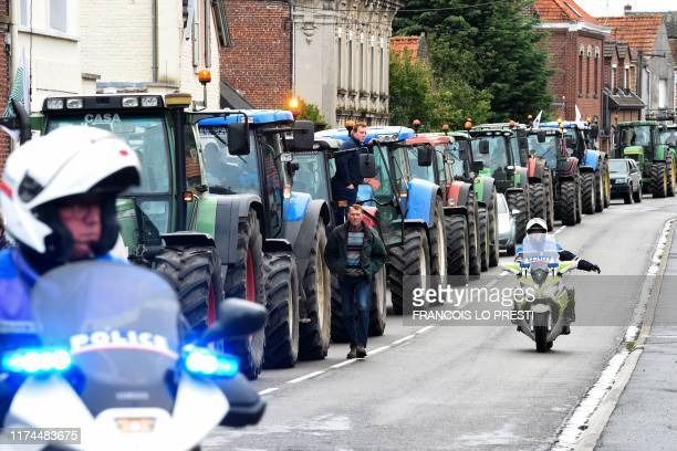 Police stand near tractors trying to reach the Saint Aybert border in Crespin northern France on October 8 2019 during a demonstration called by...