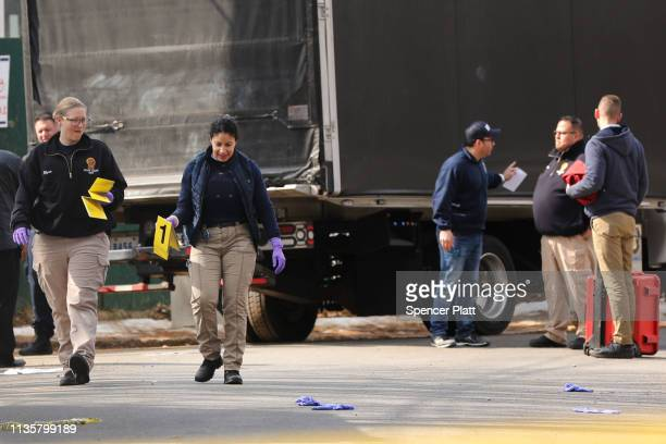 "Police stand near where reputed mob boss Francesco ""Franky Boy"" Cali lived and was gunned down on March 14 2019 in the Todt Hill neighborhood of the..."
