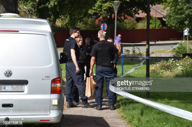 Police stand next to a cordoned zone on July 31 2018 as they investigate after Swedens royal jewels dated from the 17th century have been stolen in...