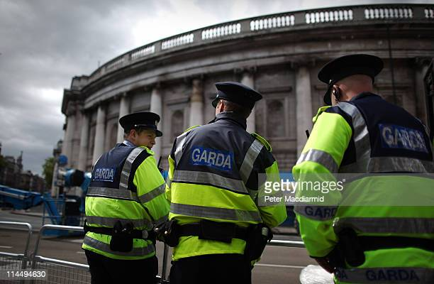 Police stand on duty outside The Bank of Ireland where President Obama will speak on May 22 2011 in Dublin Ireland President Obama is visiting...