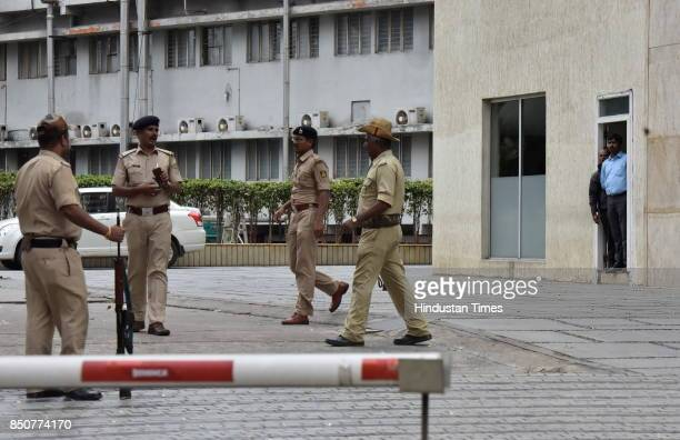 Police stand on guard as Income Tax officials raid at Coffee Day Square headquarters of Cafe Coffee Day during the raid at the properties of VG...