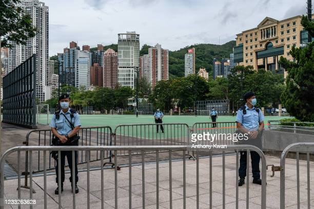 Police stand on patrol at Victoria Park, after closing a venue where Hong Kong people traditionally gather annually to mourn the victims of the...