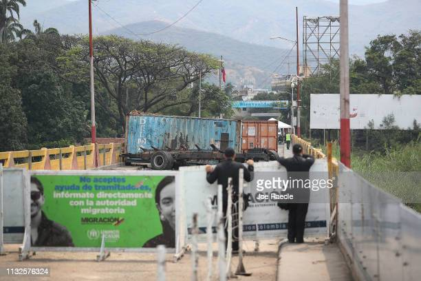 Police stand on the Colombian side of the Simón Bolívar international bridge which connects Cúcuta with the Venezuelan town of San Antonio del...