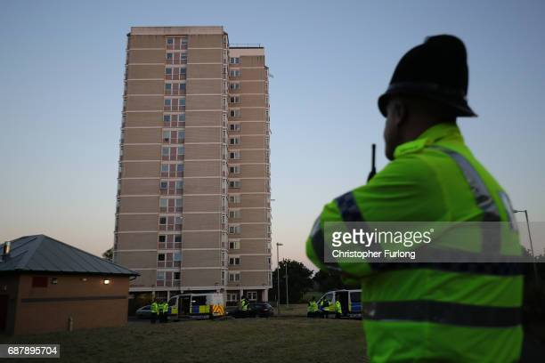 Police stand outside a block of flats in Blackley Greater Manchester where a woman was arrested in connection with the Manchester Attack on May 24...