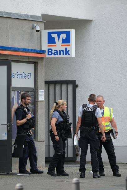DEU: Robbers Hit Bank In Berlin, Security Man Shot