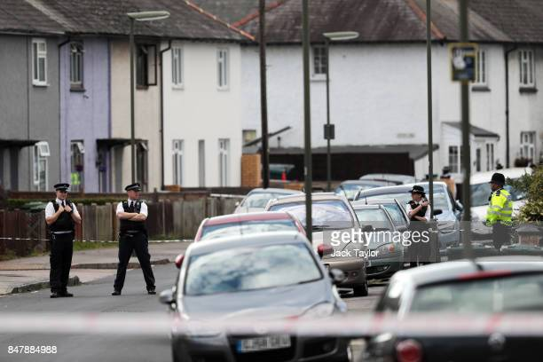 Police stand outside a property on Cavendish Road following a raid in connection with the terror attack at Parsons Green station on September 16 2017...