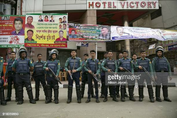 Police stand outside BNP headquarters on February 9 2018 in Dhaka Bangladesh Bangladesh former Prime Minister Khaleda Zia was sentenced on Thursday...