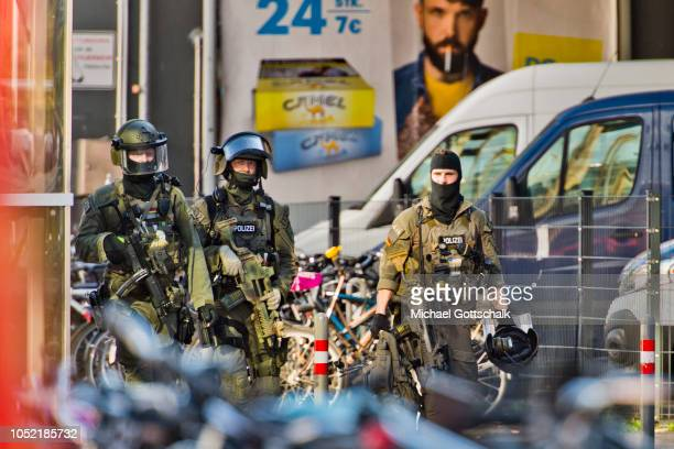 Police stand outside Cologne main railway station on October 15 2018 in Cologne Germany A police spokesman gave onsite information that a...