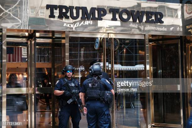 Police stand outside of Trump Tower on September 26, 2019 in New York City. Following the controversy over the phone call between Donald Trump and...