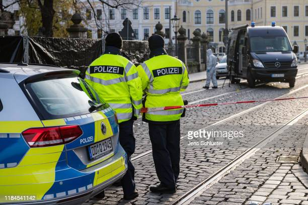 Police stand outside Residenzschloss palace that houses the Gr¸nes Gewlbe collection of treasures on November 25 2019 in Dresden Germany Thieves...