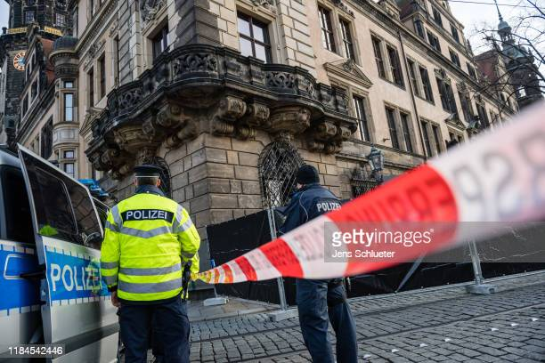 Police stand outside Residenzschloss palace that houses the Gr¸nes Gewlbe collection of treasures on November 25, 2019 in Dresden, Germany. Thieves,...
