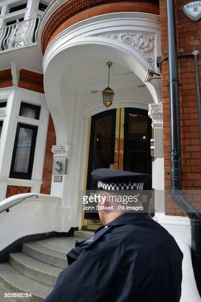 Police stand outside the Ecuadorian Embassy in London where WikiLeaks founder Julian Assange has been given asylum