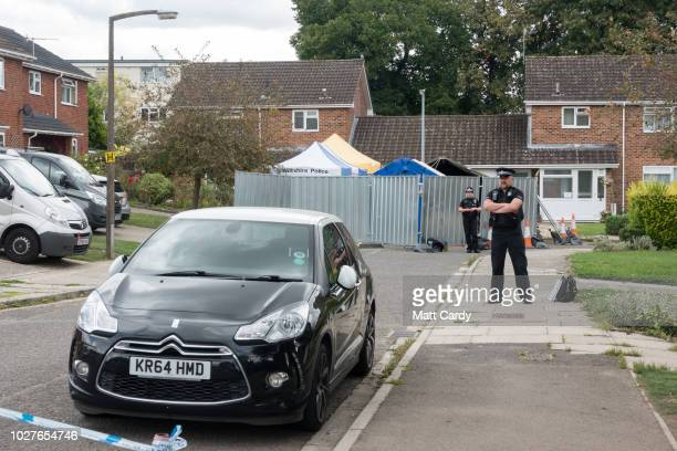 Police stand outside the former home of former Russian spy Sergei Skripal in Salisbury on September 6 2018 in Wiltshire England British Police named...