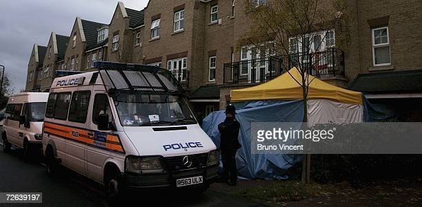 Police stand outside the residence of poisoned former Russian agent Alexander Litvinenko on November 24 2006 in London England Former Russian spy...