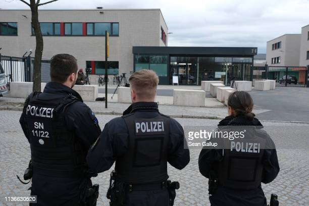 Police stand outside the trials building of the Oberlandesgericht regional court on the first day of the trial of Alaa S for the possible murder of a...