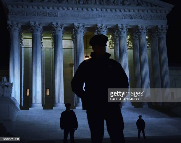 TOPSHOT Police stand outside the US Supreme Court on January 31 2017 in Washington DC President Donald Trump nominated federal appellate judge Neil...