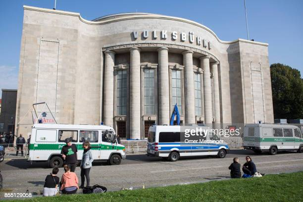 Police stand outside the Volksbuehne theater during negotiations to end the occupation of parts of the theater by activists on September 28 2017 in...
