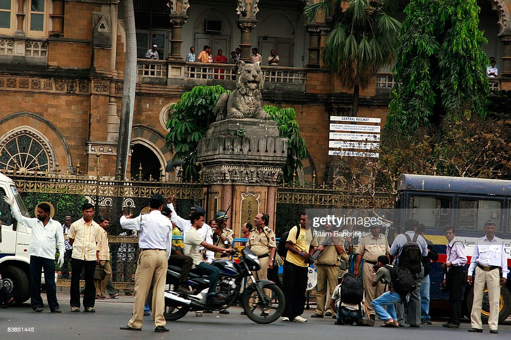 Police stand vigil outside the Chatrapati Shivaji Terminus (VT STation on November 28, 2008 in Mumbai, India. Following terrorist attacks on three locations in the city, troops are now working to free the remaining hostages being held inside the Taj Mahal Palace Hotel.