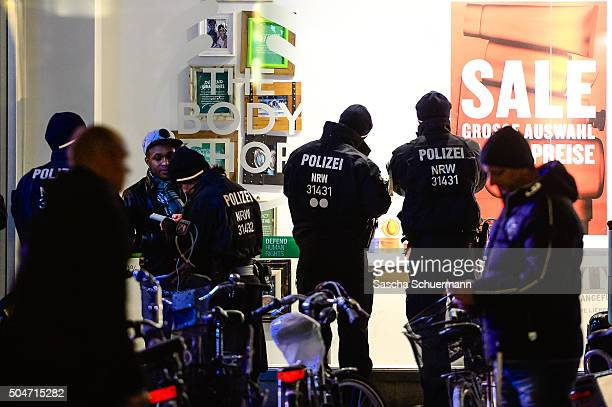 Police stand watch in front of Hauptbahnhof main railway station where on New Year's Eve gangs of what victims described as North African men...