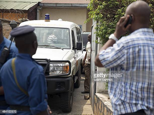 Police stand while the body of exhead of Burundi's army during its civil war Colonel Jean Bikomagu a key figure in the former Tutsidominated army is...