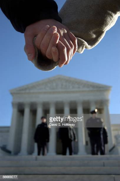 Police standing on the Supreme Court Steps survey the prayer circle during the March for Life prayer vigil in front of the Supreme court building on...