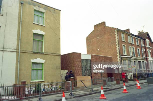 Police standing outside number 25 Cromwell Street, the home of murderers Fred and Rosemary West, 23rd April 1994.