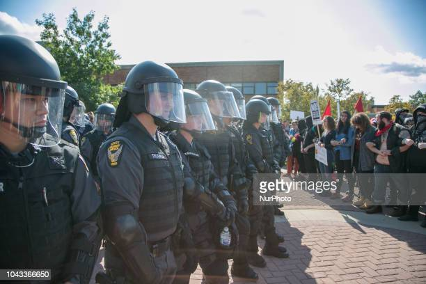 Police standoff with protesters during an open carry rally at Kent State University in Kent Ohio on September 29 2018