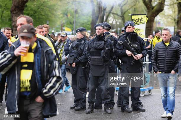 Police stands around the stadium prior to the Bundesliga match between Borussia Dortmund and Eintracht Frankfurt at Signal Iduna Park on April 15...