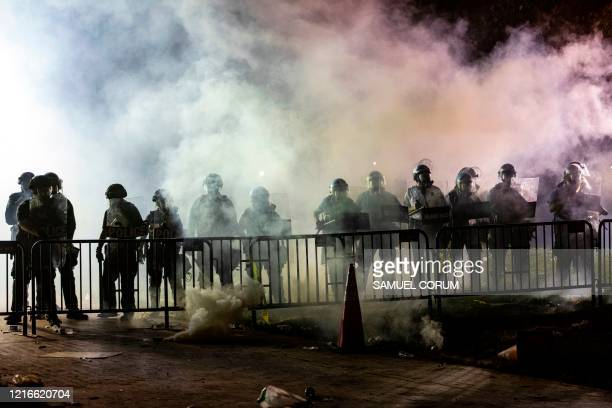 Police stands behind barricades in front of the White House during a protest against the death of George Floyd at the hands of Minneapolis Police in...