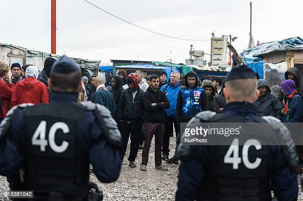Police stands during a police operation in the Calais Jungle on October 18 2016 The refugee camp on the coast to the English Channel is to be cleared...