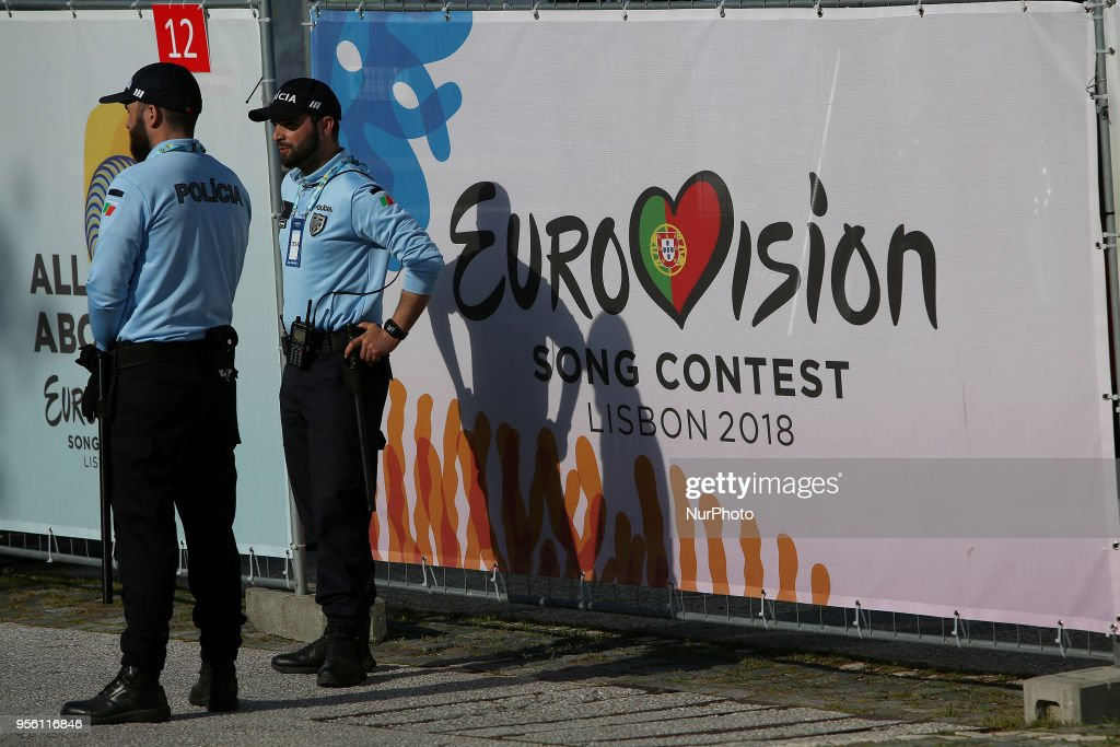 Police stands in front of the Eurovision logo before the first semi-final of the 2018 Eurovision Song Contest, at the Altice Arena in Lisbon, Portugal on May 8, 2018.