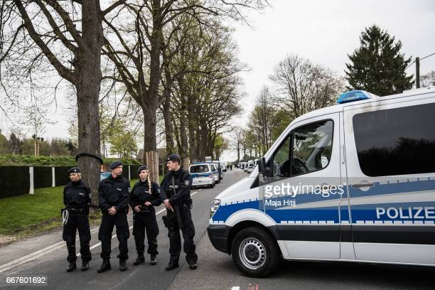 Police stands next to the hotel where explosions damaged Borussia Dortmund football club bus on April 12 2017 in Dortmund Germany According to police...