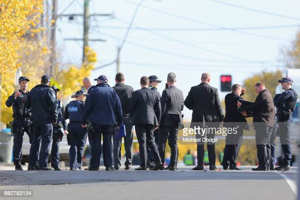 Police start their investigations outside service apartments on June 6 2017 in Melbourne Australia Police are treating an incident where an armed man...