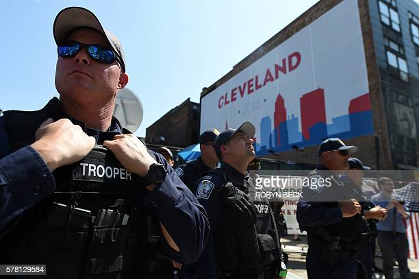 Police state troopers and other security forces are seen outside the Quicken Loans Arena in Cleveland Ohio on July 20 2016 on the third day of the...