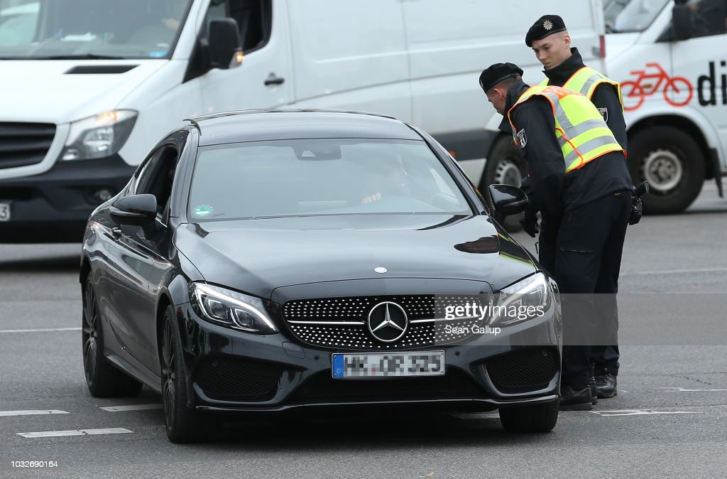 . Police stop an arriving Mercedes car at the conclusion of the funeral of Nidal R. near the New 12 Apostles cemetery during the funeral of Nidal R. on September 13, 2018 in Berlin, Germany. Nidal R., 36, a multiple felon, was gunned down by assailants who managed to flee the scene at a public park last Sunday. Berlin has a number of Arab, Kurdish and Turkish clans deeply organized in organized crime.