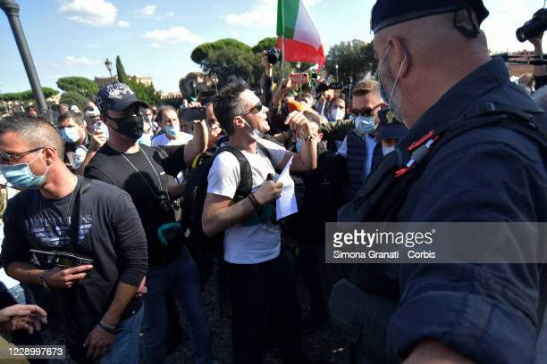 Police stop and identify a man without mask during Let's Free Italy!, Liberation March for Work, Income, Sovereignty, Democracy, in Piazza San...