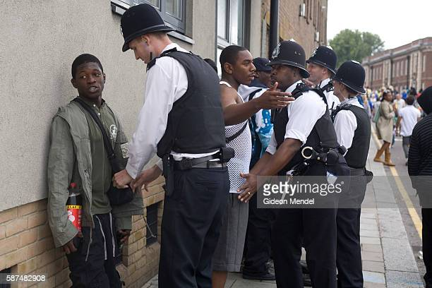 Police stop and search black youths at the entrance to the Notting Hill Carnival This was part of an initiative to combat knife crime Stop and search...