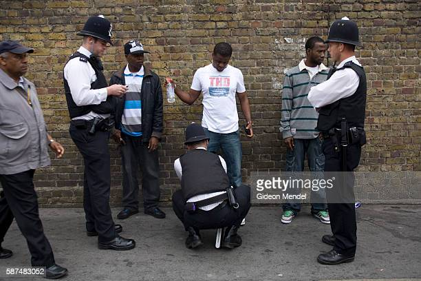 Police stop and search black youths at the entrance to the Notting Hill Carnival. This was part of an initiative to combat knife crime. Stop and...