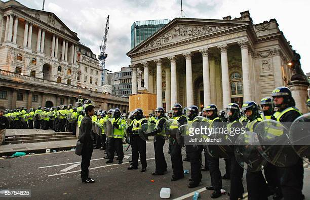 Police stop anticapitalist and climate change activists demonstrating in the City of London on April 1 2009 in London England Protesters marched...