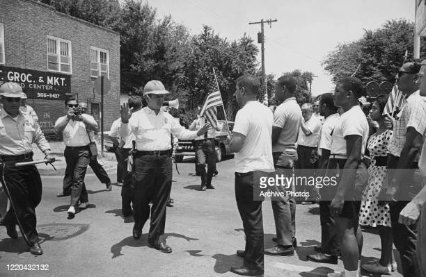 Police stop demonstrators during civil rights march in Jackson, Mississippi, 17th June 1963.