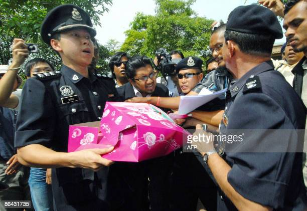 Police stop opposition party supporters outside the offices of Malaysian Prime Minister Najib Razak in Putrajaya on May 6 2009 from trying to deliver...