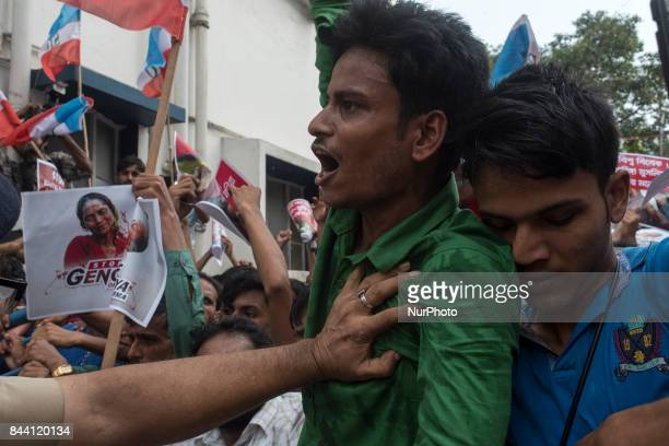 Police stopping a SIO member who was storming into the Myanmar Bhavan during the protest against the mass killing of Rohingya Muslims in Kolkata...
