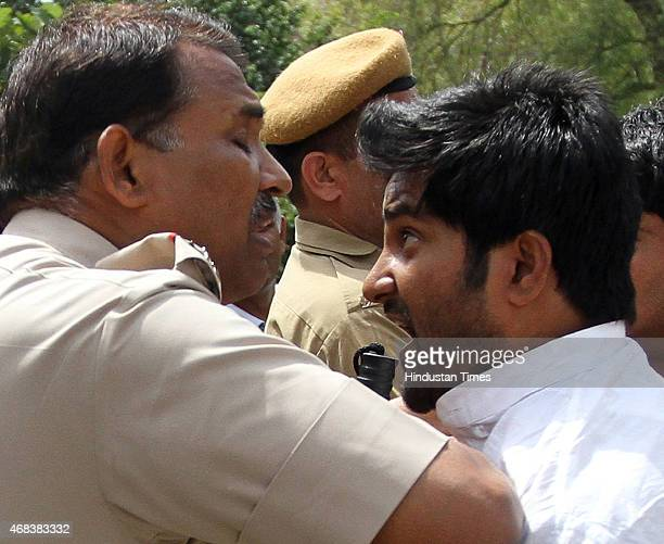 Police stopping NSUI workers as they shout slogans against BJP MP and Union Minister Giriraj Kishore to protest his derogatory remark against...
