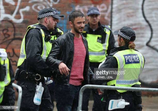 Police stops and search a visitor on the first day of the Notting Hill Carnival in west London on August 26 2018 Nearly one million people are...