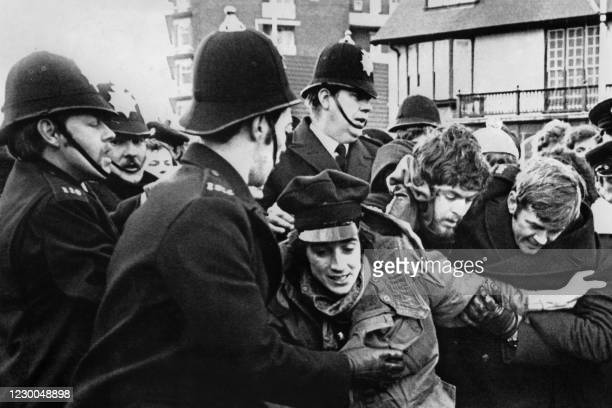 Police struggles to hold back demonstrators, on January 12, 1978 Bridlington, Yorkshire, during a series of general strikes and demonstrations called...