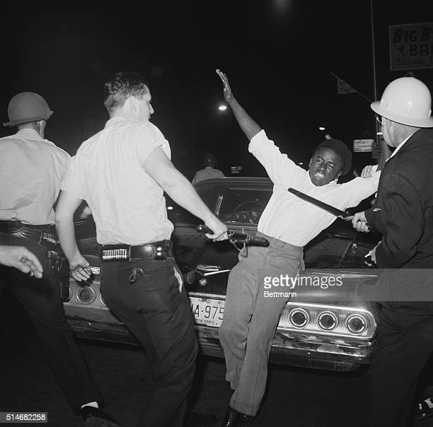 Police subdue a rioter during the second night of riots in Elizabeth New Jersey